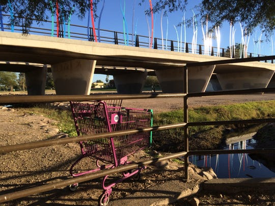 The Thomas Road bridge over Indian Bend Wash in Scottsdale features public art but remains an eyesore for the area, according to one reader. The wash is covered in rock and uneven pavement and is sometimes used by the homeless.