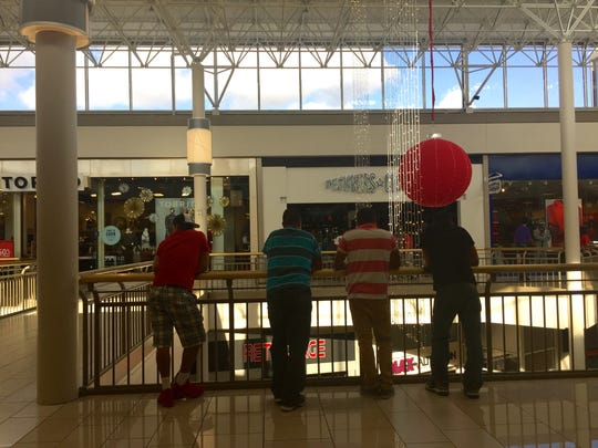 Four customers wait for relatives to check out.