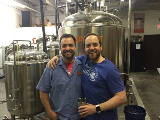 Lost Borough Brewing co-founders Dan Western, left, and Dave Finger stand in the brewing space of their Atlantic Avenue brewery.