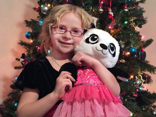 Madison Catron, 7, of Grimes, received a Cheer Box from Amanda the Panda last year after her father died.