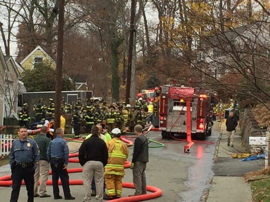 Dozens of responders battle a house fire on Chestnut