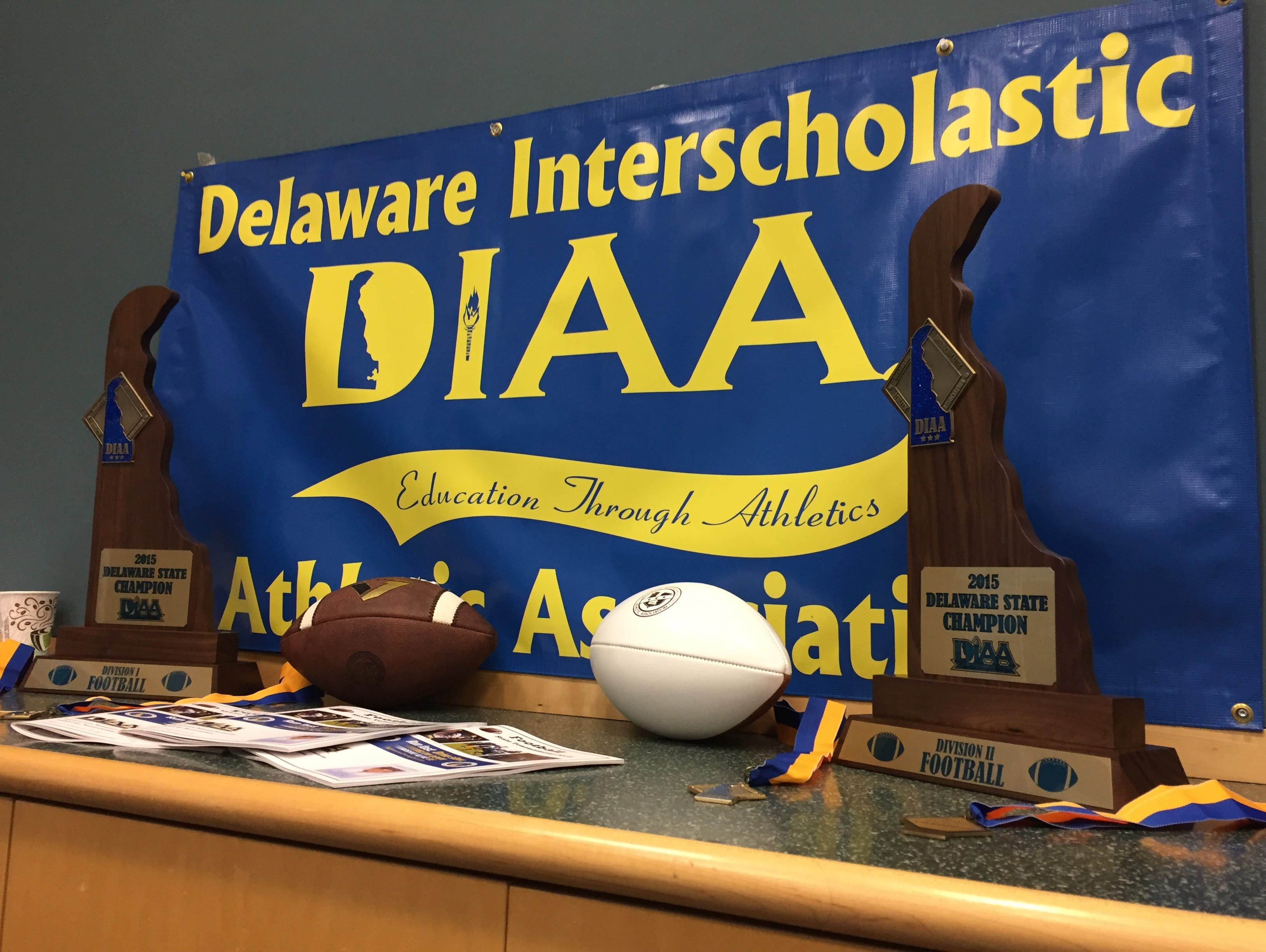 The Division I and II football trophies were on display at The News Journal on Monday.