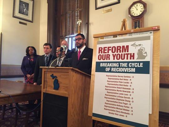 Rep. Harvey Santana, D-Detroit, surrounded by colleagues