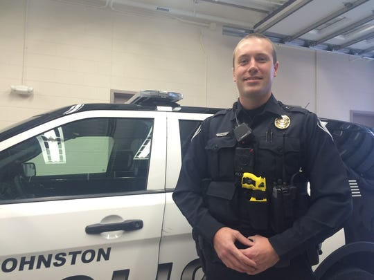 Officer Matt Chiles of the Johnston police helped with a surprise engagement on Thanksgiving.