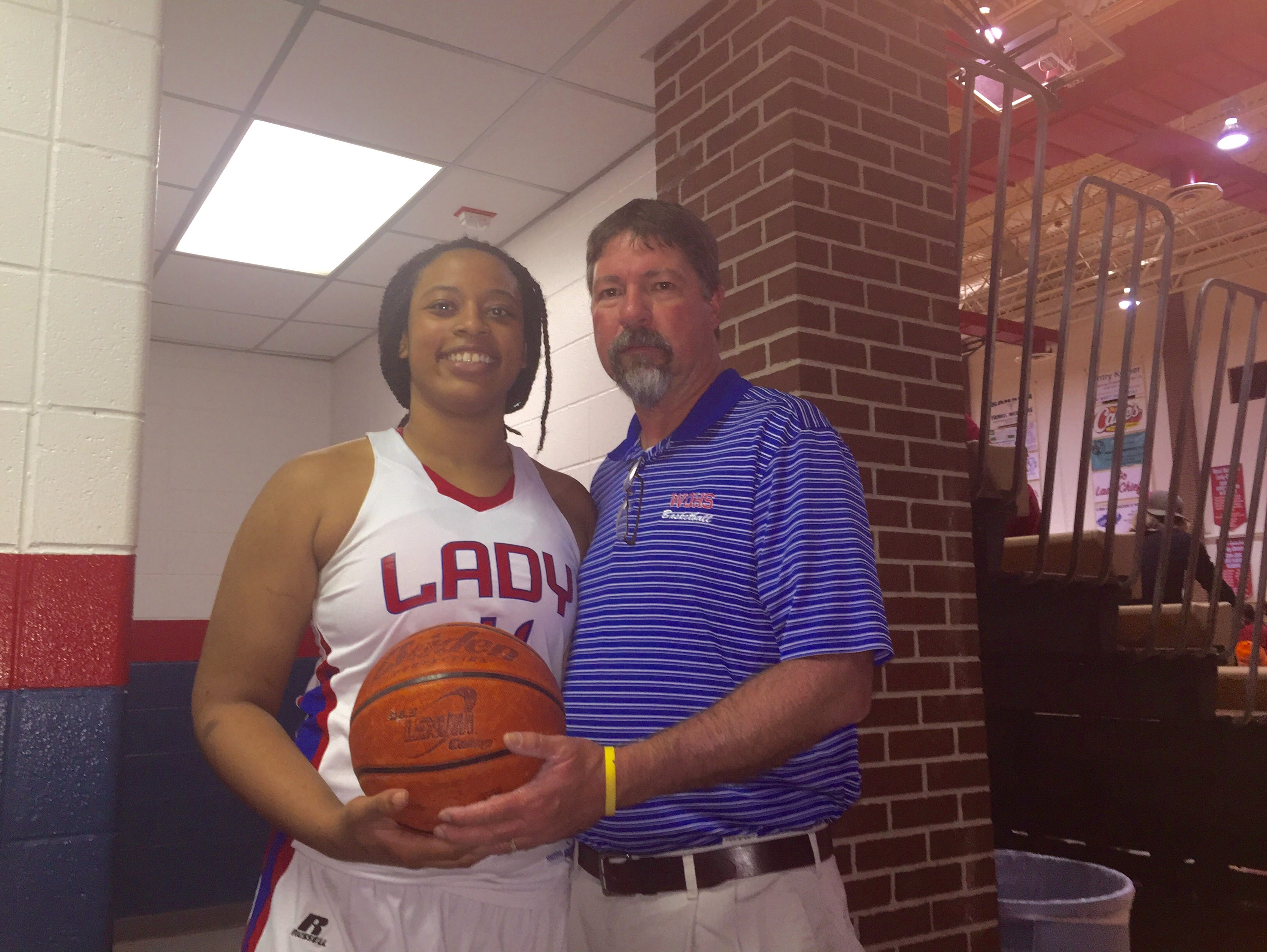 West Ouachita senior forward Trinity Griffin (left) with coach Jimbo Murphy following Griffin scoring her 1,000 point in her career.