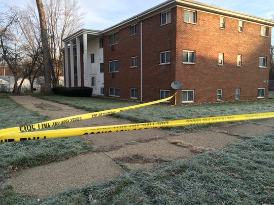 Police found a man with a gunshot wound to his head outside a building early this morning