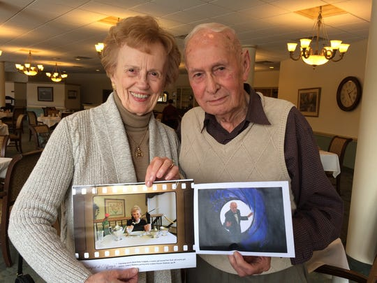 Eleanor Pinkham and Bruce Greenman, residents at Burcham Hills, show their photos from the 2016 calendar.