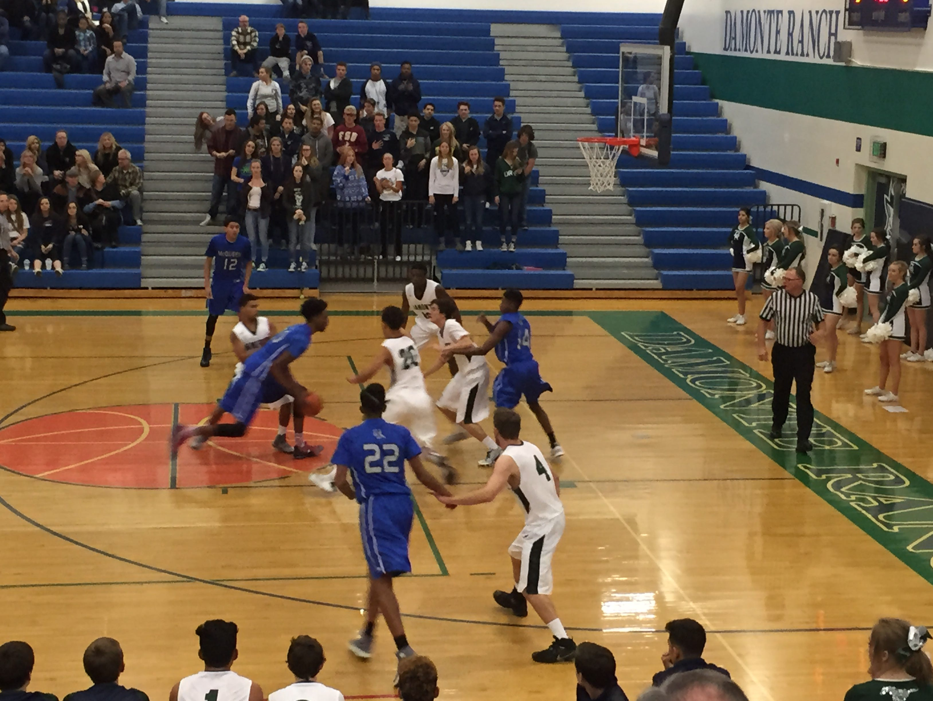 McQueen's Octavian Corley drives to the basket Tuesday at Damonte. McQueen won, 75-51