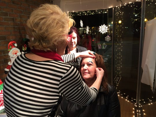 Howell's Holly Hatter gets her eyebrows waxed Thursday