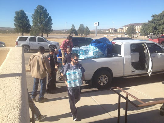 A truckload of water donated by the Carlsbad business