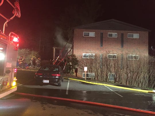 Smoke emanates from Westall Apartments in North Asheville Friday night. No one was injured.