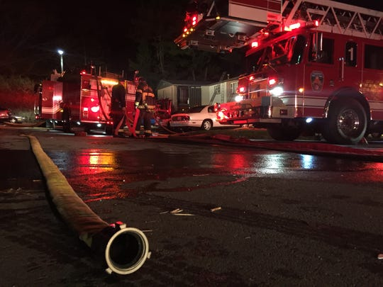 A fire displaced about eight families from a two-story North Asheville apartment building.