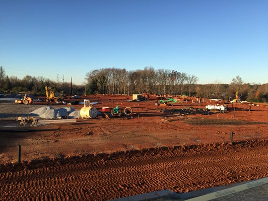 McCrory Construction Co. workers at work Friday on The Crossing at Five Forks, a senior living complex behind Walgreen's at the corner of Woodruff Road and Five Forks Road in Simpsonville.