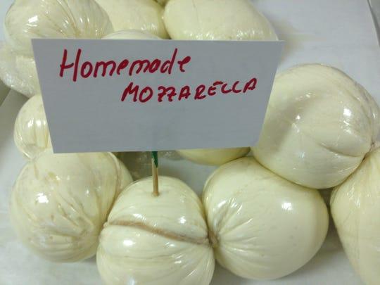 Owner Michele Romano makes his own mozzarella at Cafe