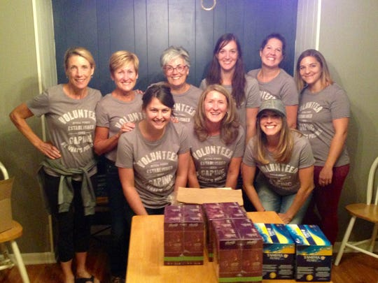 Athleta employees prepare to sort sanitary supplies collected for women in need.