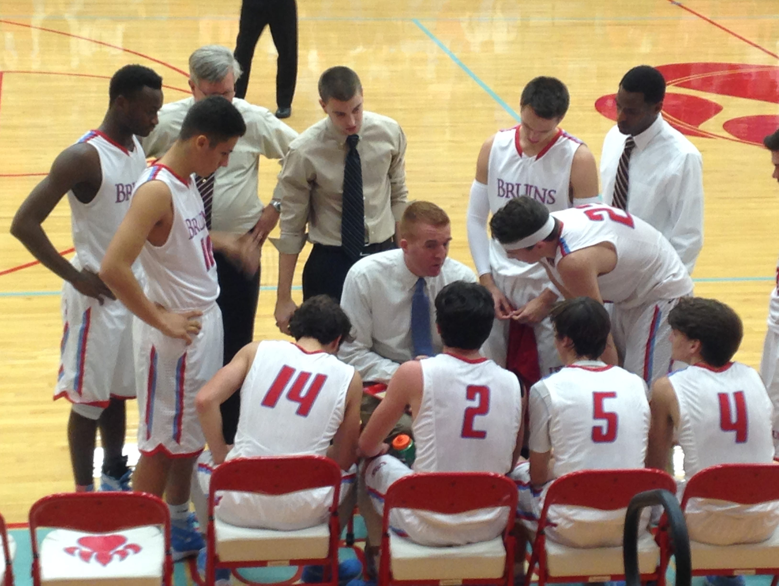 USJ coach Oliver Simmons talks with his players near the end of the Bruins' 69-60 win Friday over Dyer County.