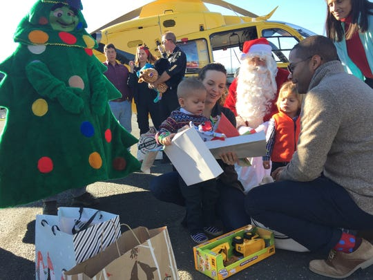 Brady Kier, 2, and his family were surprised by a visit from Santa on Saturday.