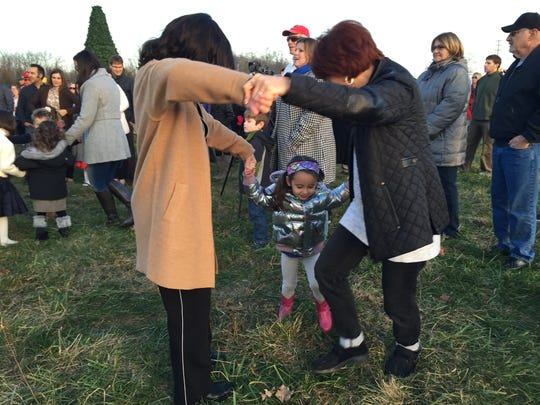 Friends and families danced to the Hanukkah songs played by the Odessa Klezmer Band as they celebrated the first night of Hanukkah. The state's largest Menorah was lit for the first night of Hanukkah at sundown Sunday by Chabad Jewish Center of Monroe.