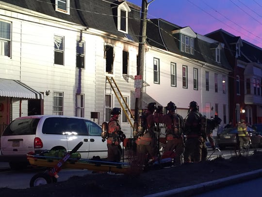 Crews respond to scene of a house fire, reportedly caused by an inadequate extension cord plugged into a space heater, in the 700 block of East Philadelphia Street in York on Sunday, Dec. 6, 2015.