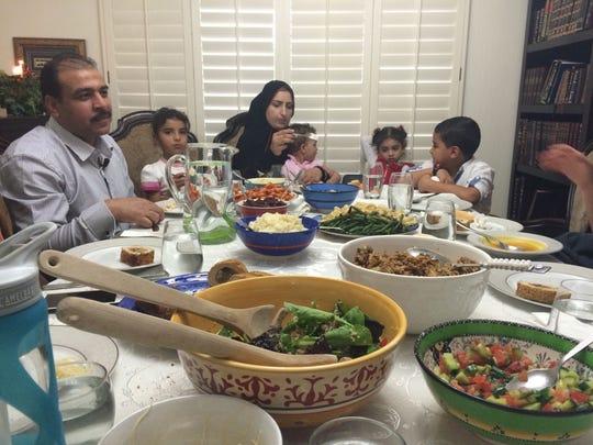 Syrians Emad Al Wazer, his wife, Noor Al Mousa, and