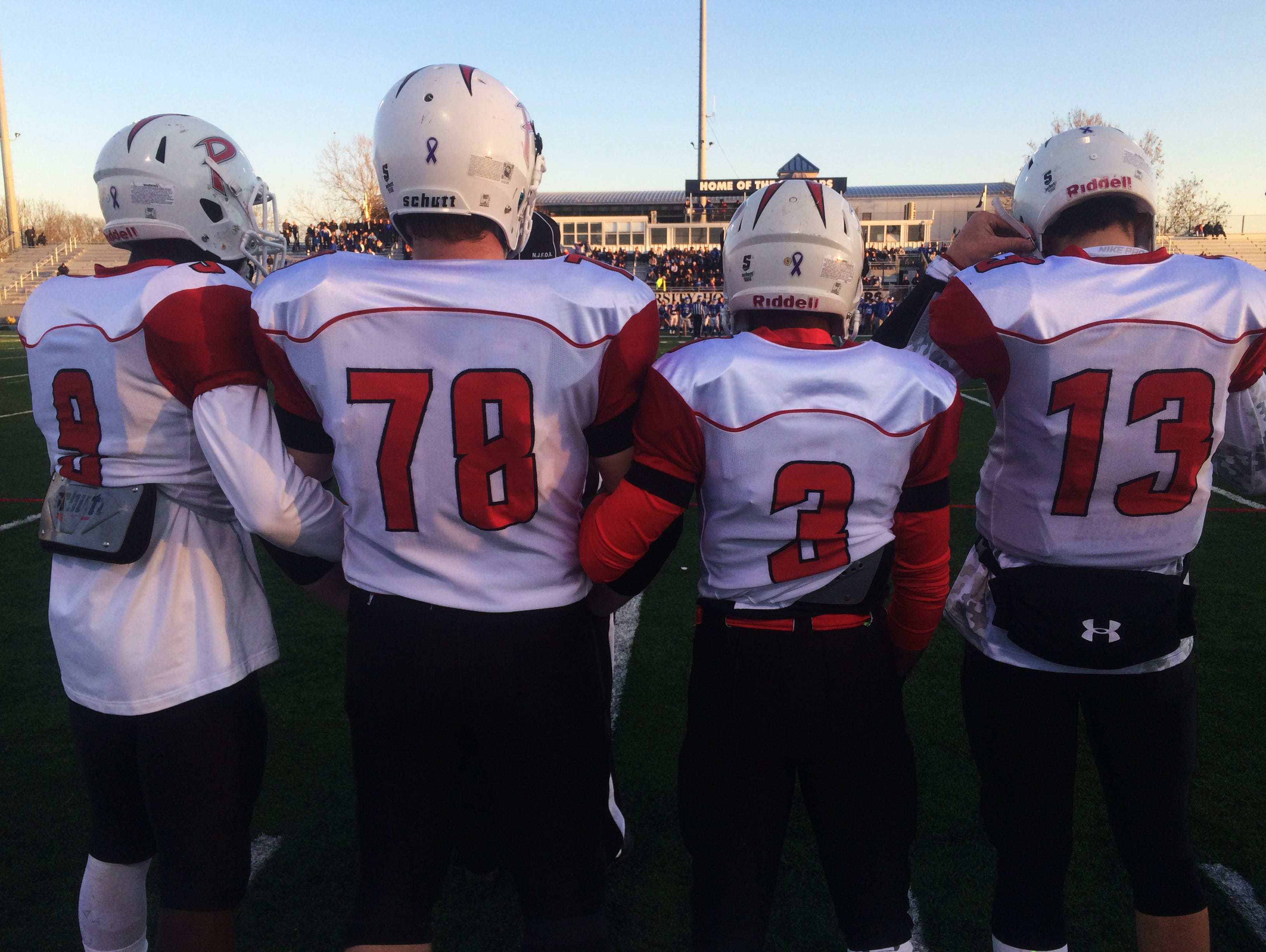 Palmyra High School football captains Kelvin Harmon (9), Noah Stephenson (78), Kam Kennedy (3) and Max Smyth (13) ready for the coin toss before Dec. 5's Central Jersey Group 1 championship at Kean University.