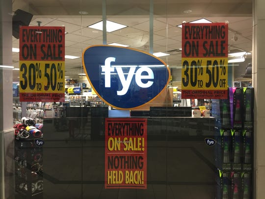 Signs announce the going-out-of-business sale at F.Y.E. in the Burlington Town Center mall in downtown on Tuesday.