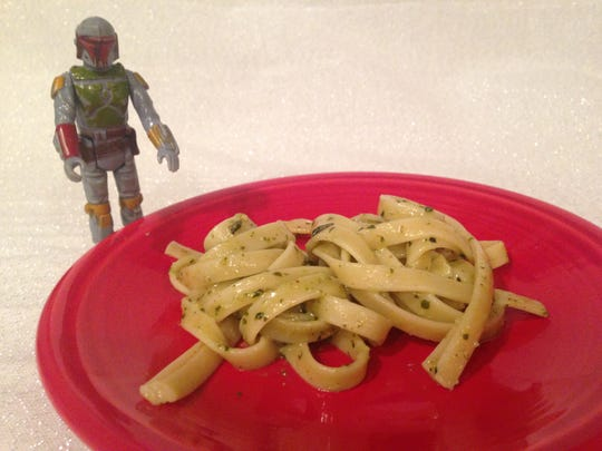 Basic fettuccine, tossed with pesto, becomes Boba Fettuccine. Many foods can become Star Wars themed foods with a little creativity.
