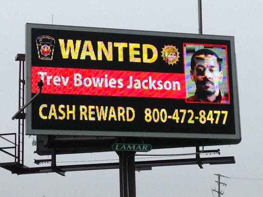 A billboard on Carlisle Road in West Manchester Township asks for help in locating fugitive Trev Bowies Jackson.