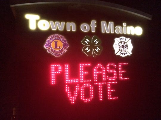 The Town of Maine's sign asks residents to vote Tuesday,