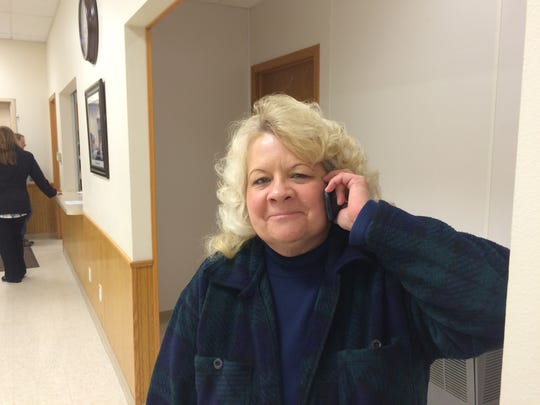Maine Town Chairwoman Betty Hoenisch talks on the phone