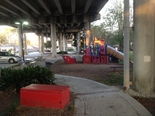 Walking paths and playground equipment are part of