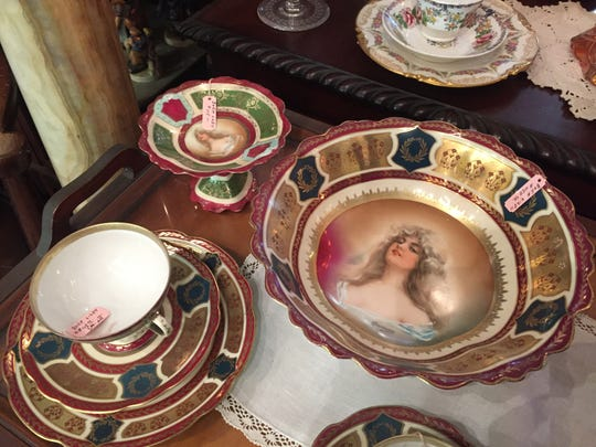 Among the items for sale at The Owl's Tale: fine and antique china and silverware.