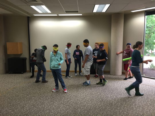 Students participate in a challenge during the leadership camp hosted by Utah State University.