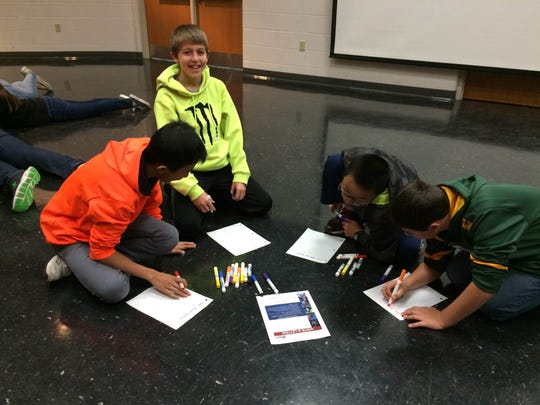 High Five students from D.C. Everest Middle School write letters to active service members.