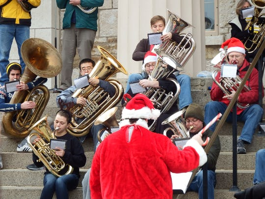 Decked out in a Santa Claus suit, University of Iowa
