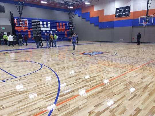 Members of Washington County's Leadership Dixie team tour the gym of Hildale's Water Canyon School on Thursday. The gym is part of a warehouse that is being remodeled to become a new high school at the site of the K-12 campus in the mostly polygamous community.