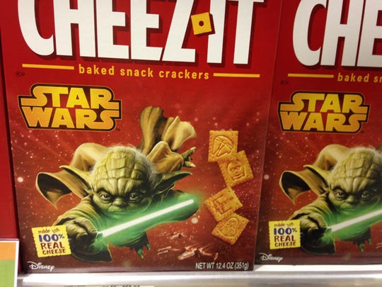Snack crackers are printed with Star Wars shapes, like
