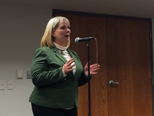 Lisa Green-Douglass, the Democratic nominee for Johnson County Supervisor, speaks to Democrats on Wednesday night.
