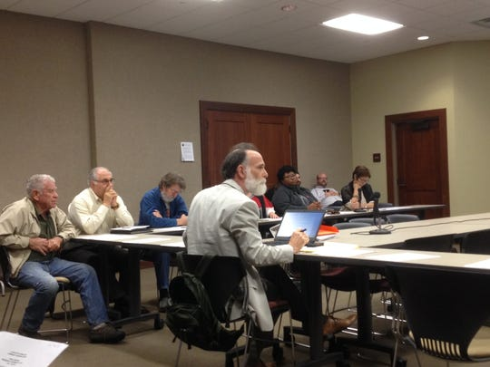 Harry Weiss and other members of the Lafayette I-49 Connector Community Working Group met unofficially Wednesday, Dec. 16, 2015.
