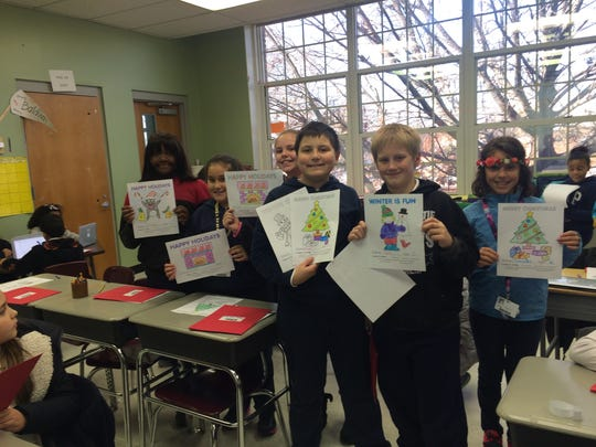 Displayed are many of the K-Kids hard at work as well as the following students displaying their final masterpieces: from left to right: Briana Harmon, Natalia Silva, Kelly Wyszynski, Cristian Medeiros,  Joshuahe Graeper, and Samantha Santiago.