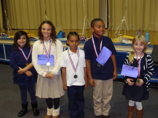The Brain Bowl's winning team consisted of 5 Linden students: l-r Cristina Ramos-Rodriguez (No. 6), Madeline Cannon-Falcao (No. 6), Jah'bron Goff (No.. 2), Rashon Thorne (No.1), and Karlee Petty (No. 10).