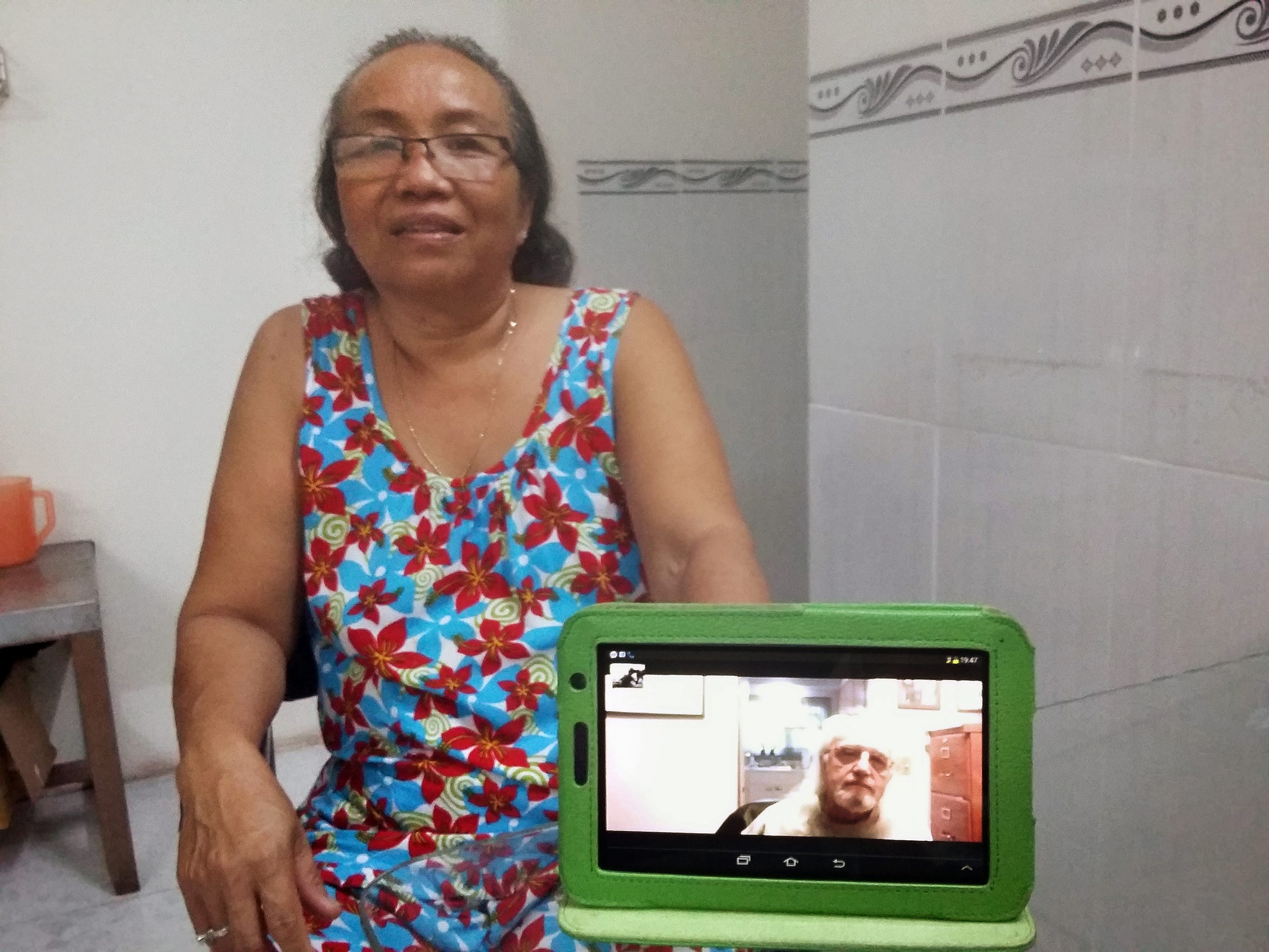 From her home in Vietnam, Kim Hoa uses a Skype-like program to communicate with Jim Reischl in St. Cloud.