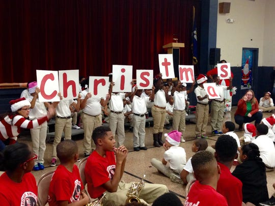"W.O. Hall Elementary students perform a poem with lines starting with each letter of the word ""Christmas."""