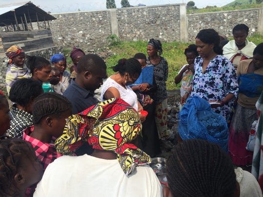 Tompkins making soap with the women of Congo