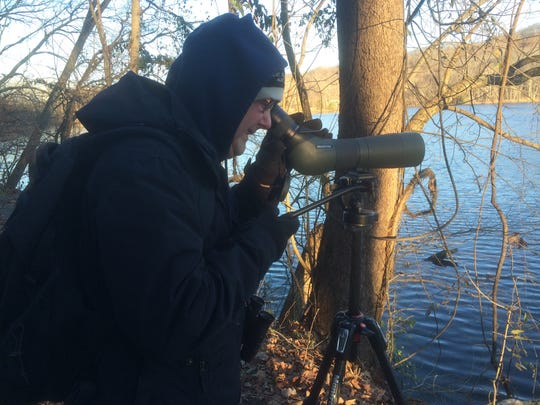 Oliver McIntyre peers through a scope, trying to get a better look at the birds on Radnor Lake on Saturday, Dec. 19, 2015. It was McIntyre's first time participating in a Christmas Bird Count.