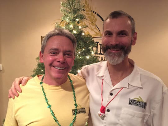 Knucklehead Brewing co-founders Len Dummer, left, and George Cline at their brewery's first-anniversary party on Saturday.