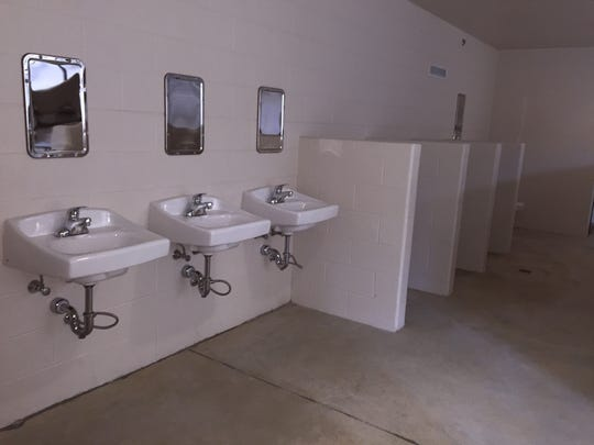 Sinks and toilets are located below a dorm area with bunks in the new Stewart County Detention Center.