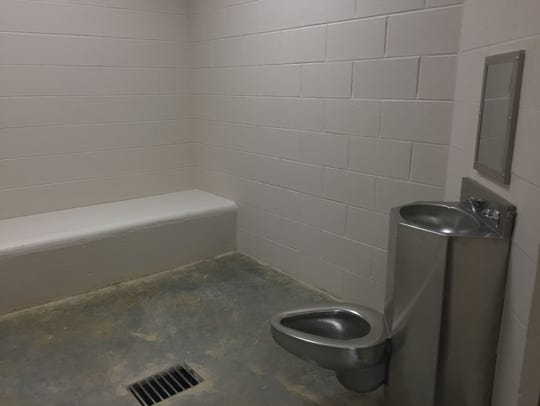 A holding cell in the booking area is equipped with