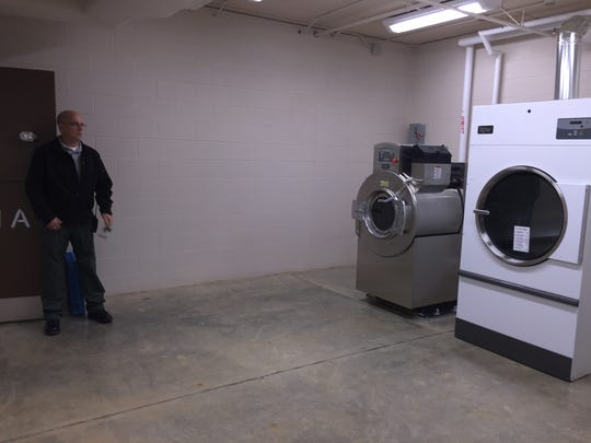 Stewart County Sheriff Deryk Wyatt show the laundry room for the new jail. The jail can be expanded to double the number of inmates but only another washer and dryer will have to be purchased to accommodate the expansion.