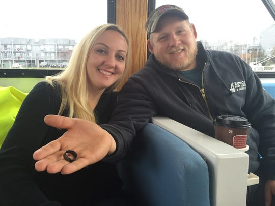 Newly-weds Meagan Bradford, 29 (left) and Jay Bradford 27, both of Point Pleasant with the Jay's wedding ring, which was recovered off the ocean floor.